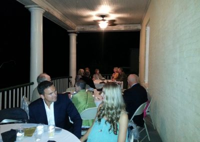 Some guests enjoyed dining on the porch of the mansion